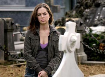 Eliza Dushku pouting in cemetery